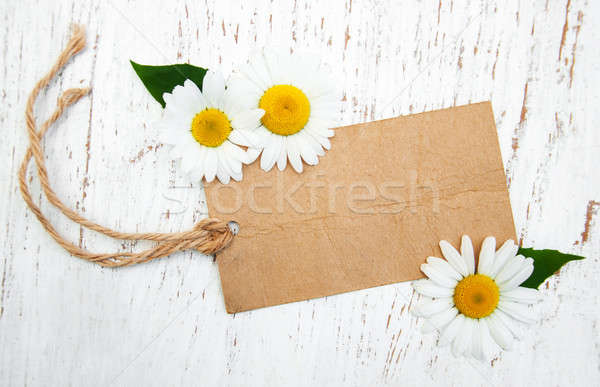 Stock photo: Chamomile flowers with vintage tag