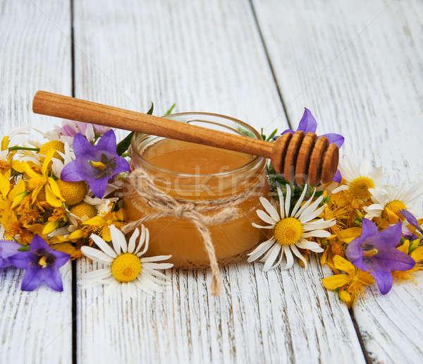 банку меда Полевые цветы старые деревянный стол цветок Сток-фото © almaje