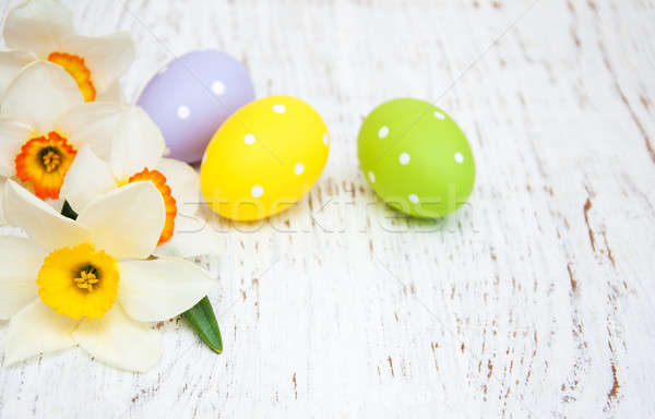 Easter eggs and daffodils Stock photo © almaje
