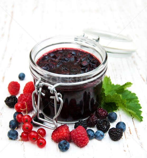 Jam and fresh berries Stock photo © almaje