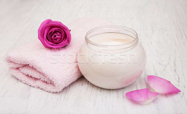 spa essentials cream with towels and rose Stock photo © almaje