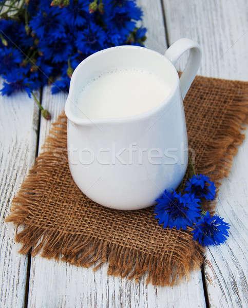 банку молоко старые деревянный стол цветок природы Сток-фото © almaje