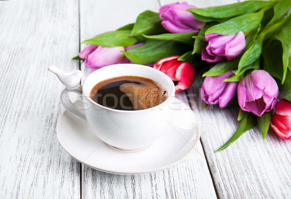 cup of coffee with tulips Stock photo © almaje