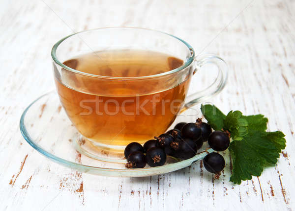 Cup of tea and black currant Stock photo © almaje
