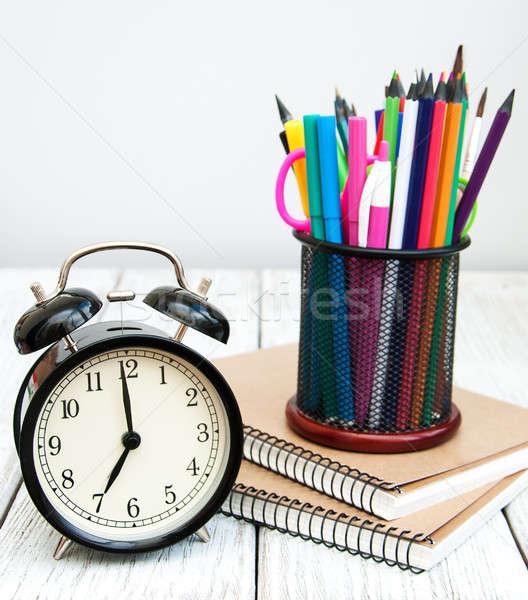 Iskola irodaszerek öreg fa asztal könyv óra Stock fotó © almaje