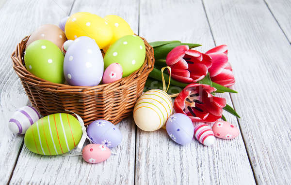 basket with easter eggs and tulips Stock photo © almaje