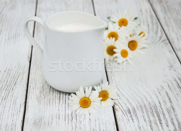 jug with milk  and chamomile flower Stock photo © almaje