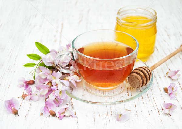 tea and honey with acacia blossoms Stock photo © almaje