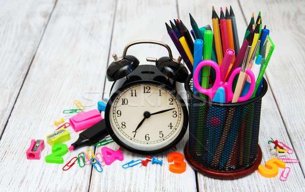 Szkoły drewniany stół książki zegar jabłko Zdjęcia stock © almaje
