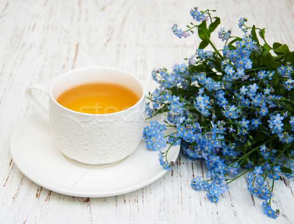 Cup of teand forget me not flowers Stock photo © almaje
