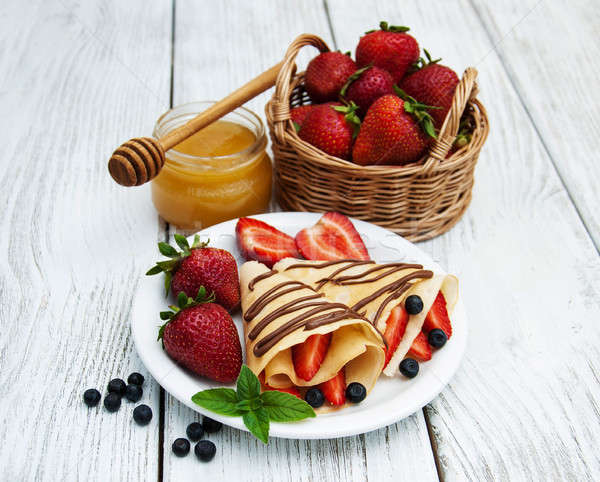 crepes with strawberries and chocolate sauce Stock photo © almaje