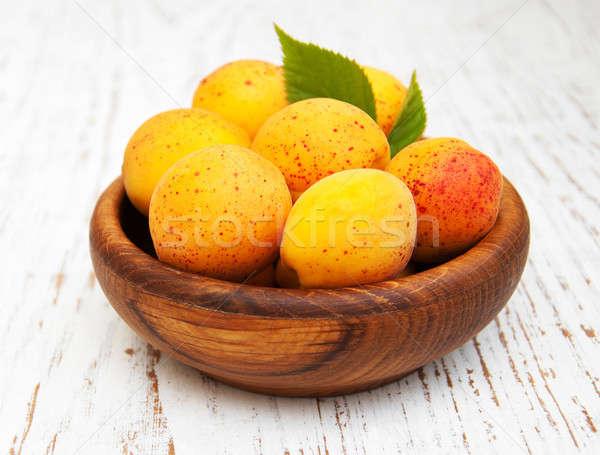 Bowl with apricots Stock photo © almaje