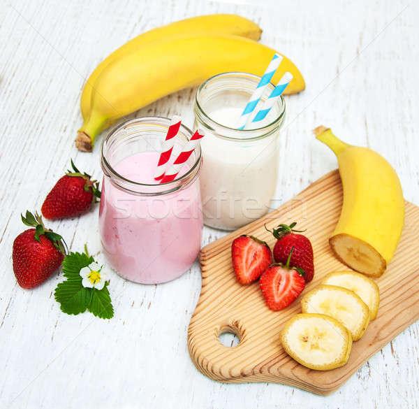 Yogurt with fresh banana and strawberries  Stock photo © almaje