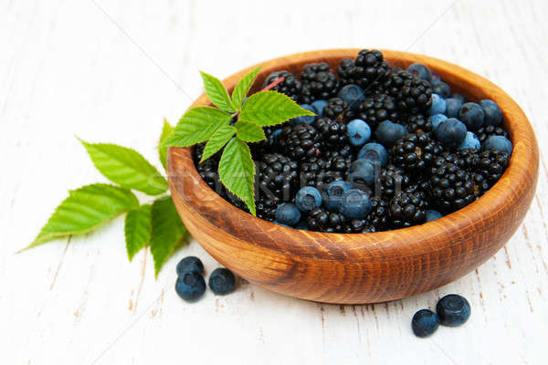 Bowl with Blueberries and blackberries  Stock photo © almaje