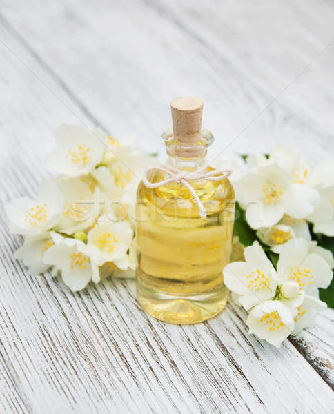 Massage oil with jasmine flowers Stock photo © almaje