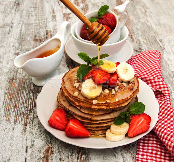 Pancakes with strawberries and bananas Stock photo © almaje