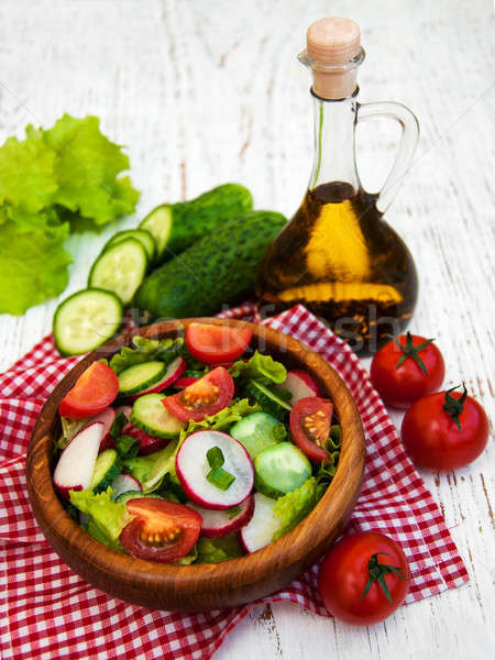 Spring salad with tomato, cucumbers and radish Stock photo © almaje
