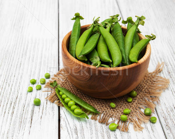 Stock photo: green peas on a table