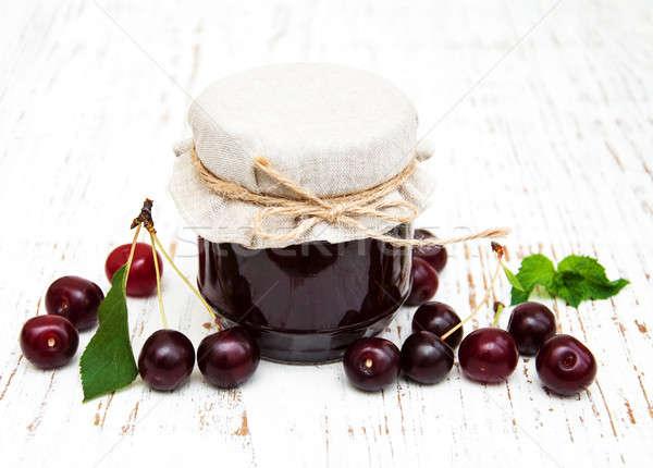 Stock photo: Cherry jam with fresh berries