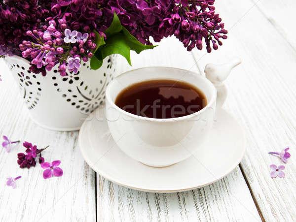 Кубок чай сирень цветы деревянный стол природы Сток-фото © almaje