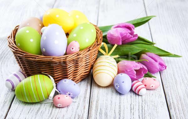 Kosár húsvéti tojások tulipánok fa asztal virág virágok Stock fotó © almaje