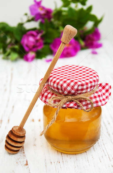 Honey and rose flowers  Stock photo © almaje