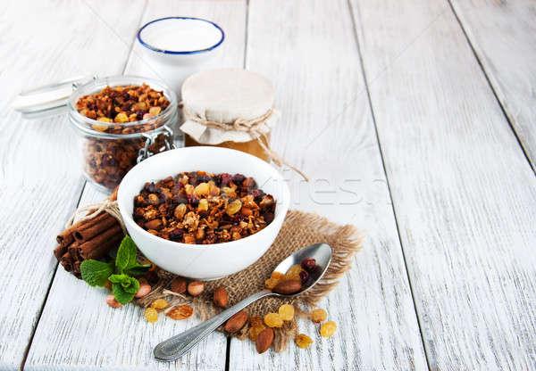 Házi készítésű granola diók tej méz fa asztal Stock fotó © almaje