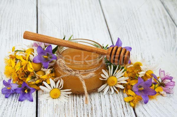 Bögre méz vadvirágok öreg fa asztal virág Stock fotó © almaje