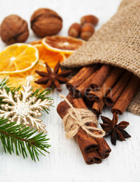 different kinds of spices,  nuts and dried oranges Stock photo © almaje