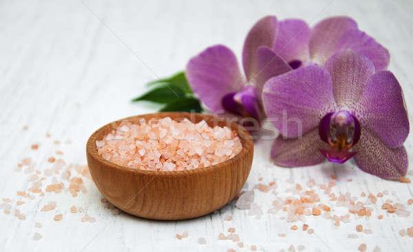 Zeezout roze orchideeën houten licht achtergrond Stockfoto © almaje