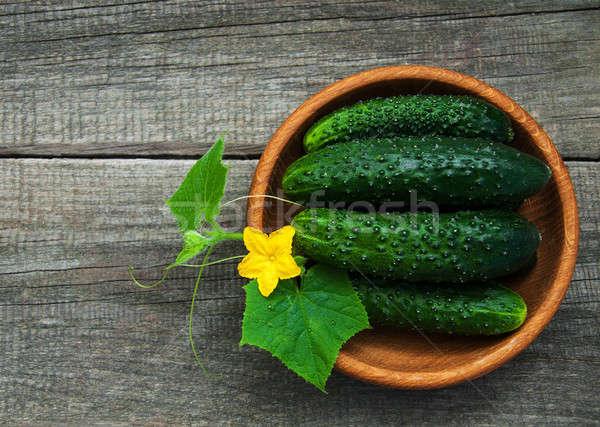 Fresh cucumbers on a table Stock photo © almaje
