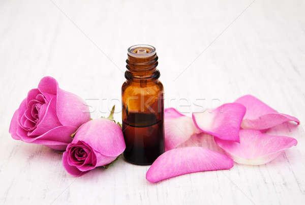 стекла бутылку Розовые розы цветы тело Сток-фото © almaje