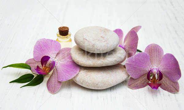 Сток-фото: Орхидеи · массаж · камней · цветок · аннотация