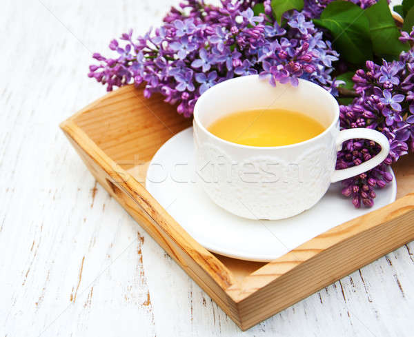Fincan çay çiçekler eski ahşap Stok fotoğraf © almaje