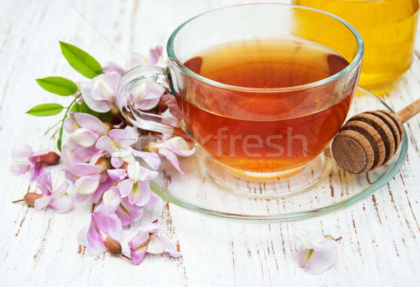 Cup of tea with acacia flowers Stock photo © almaje