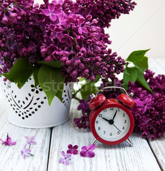 Orgona virágok ébresztőóra öreg fa asztal óra Stock fotó © almaje