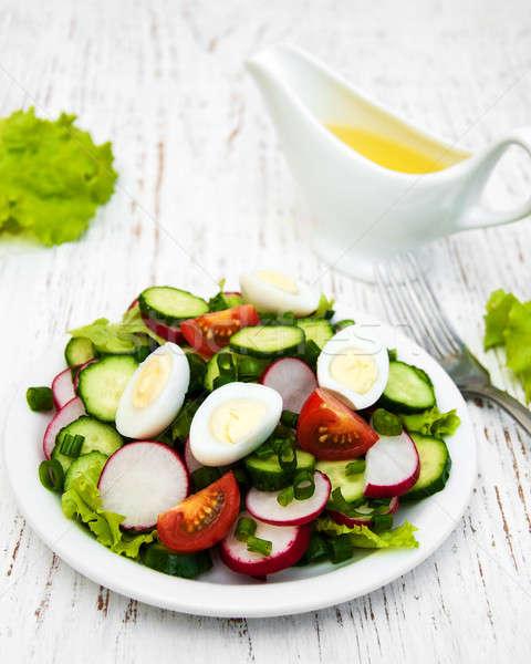 Voorjaar salade eieren komkommers radijs houten Stockfoto © almaje