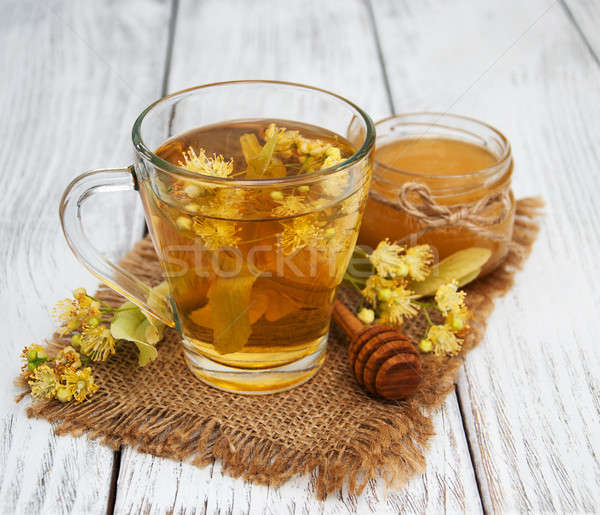 Copo chá medicinal flores velho Foto stock © almaje