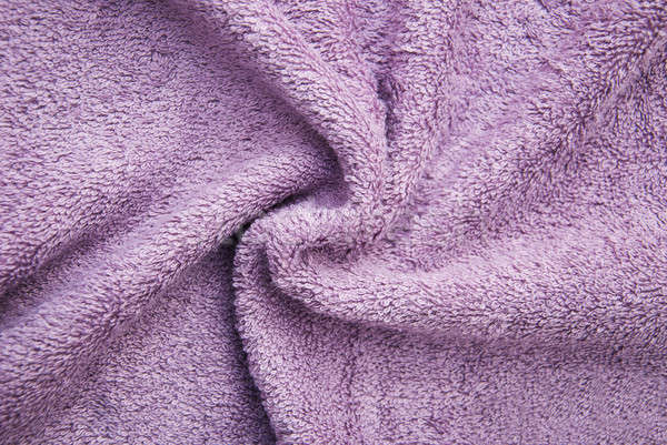 Lila fürdőkád bolyhos törölköző szövet szín Stock fotó © almaje