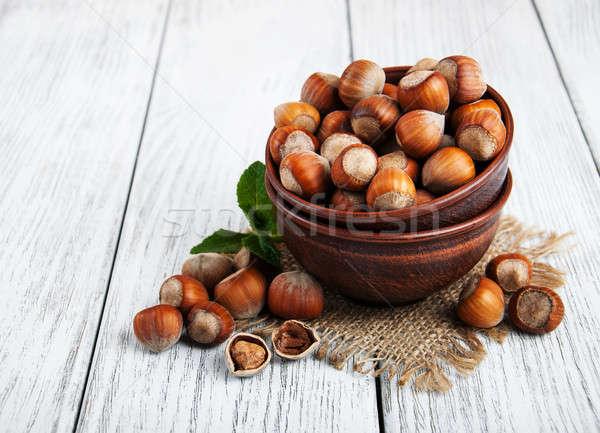 Kom hazelnoten oude houten tafel voedsel hout Stockfoto © almaje