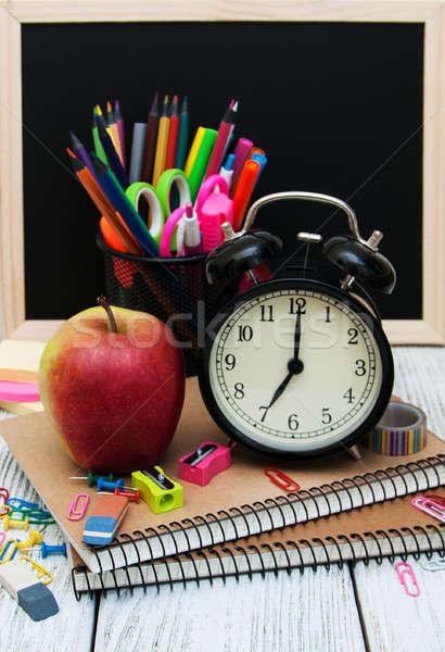 Okul ahşap masa kitap saat elma Stok fotoğraf © almaje