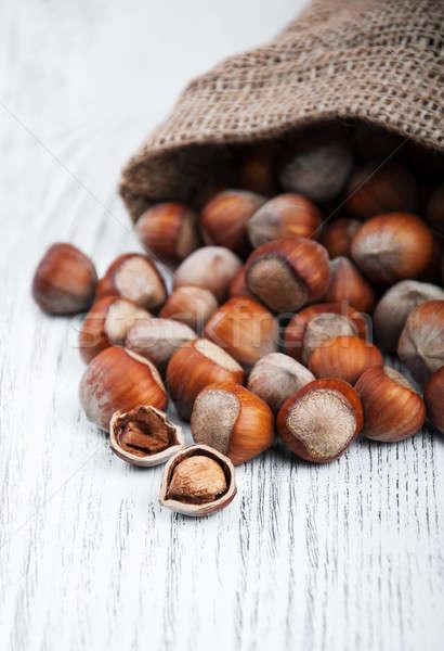 Organikus mogyoró táska öreg fa asztal textúra Stock fotó © almaje