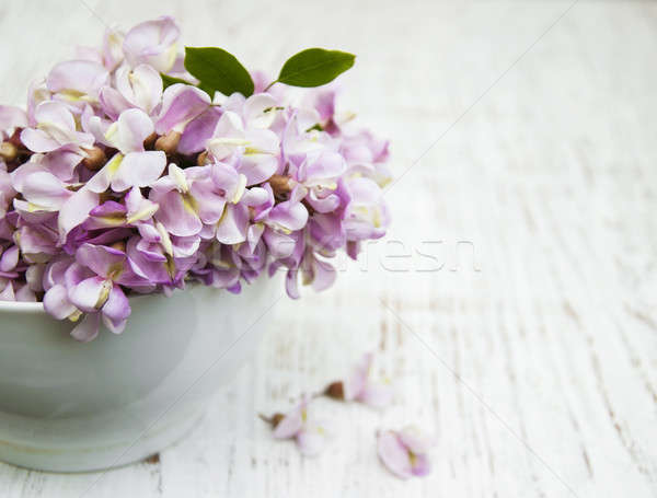 Bowl with acacia flowers Stock photo © almaje