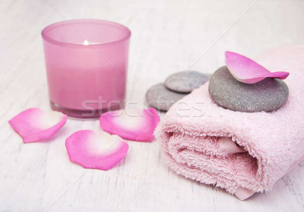 Bath towels and candle with pink roses Stock photo © almaje
