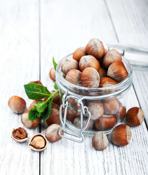 organic whole hazelnuts in a glass jar Stock photo © almaje