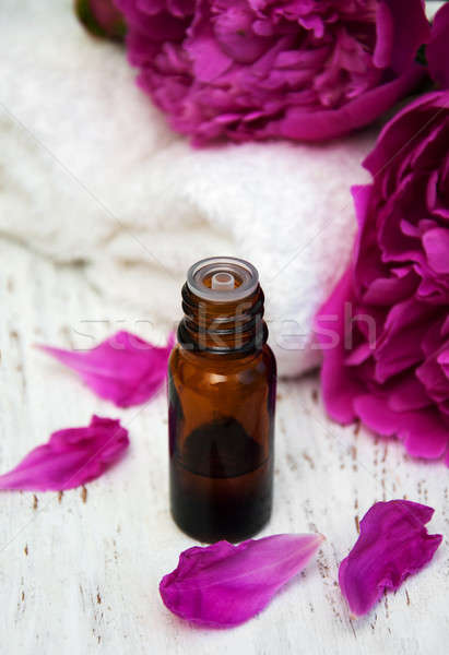 Peony flowers and massage oils Stock photo © almaje