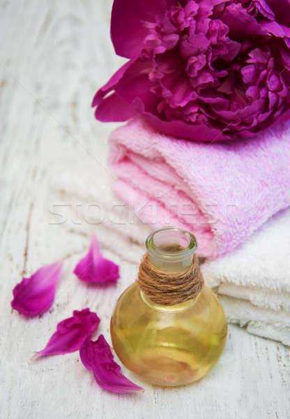 Peony flowers and massage oils Stock photo © almaje