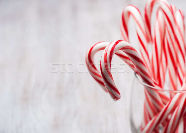 Glass  with christmas candy canes Stock photo © almaje
