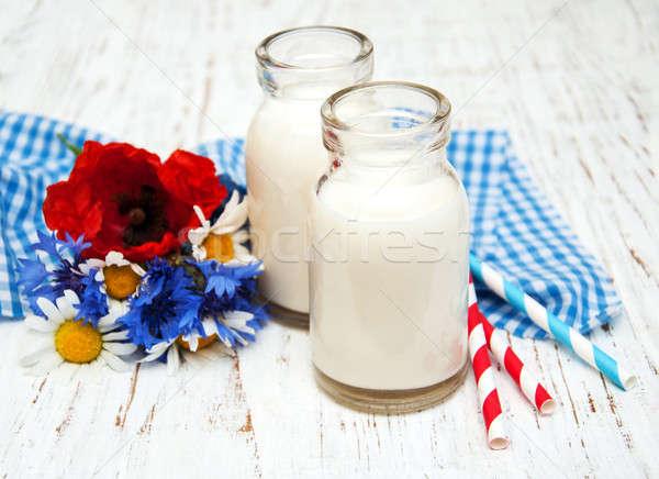молоко Полевые цветы старые цветок продовольствие Сток-фото © almaje