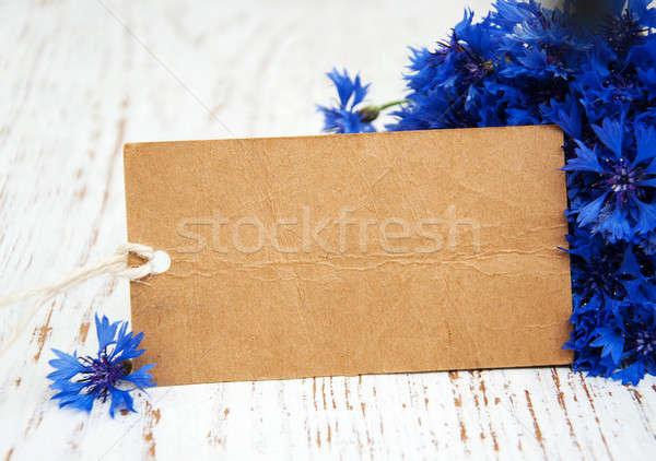 Fehér kártya virágcsokor kék öreg fából készült Stock fotó © almaje